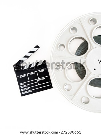 Original vintage big movie reel for 35 mm cinema projector loaded with film, with clapper board on white background - stock photo