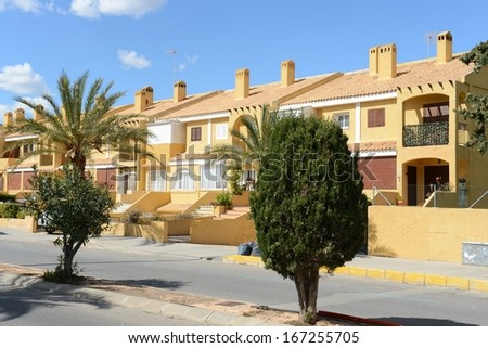 ORIHUELA COSTA, SPAIN - APRIL 6:  Orihuela Costa is recognized as the cleanest ecological region of Europe.  Residential complex in April 6, 2013 in Orihuela Costa, province of Alicante, Spain.
