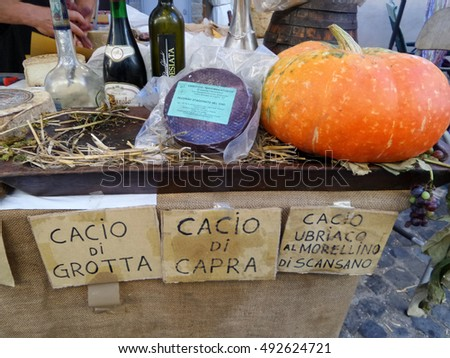 ORIOLO ROMANO, ITALY - SEPTEMBER 25, 2016: Italian cheese, wines, schnapps and pumpkins in sale on stand with the occasion of Porcini Mushrooms Festival.