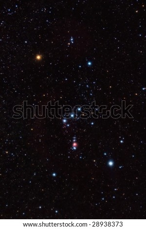 Orion constellation and nebula and star field - stock photo