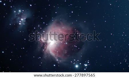 Orion Nebula Night sky  The Orion Nebula is a diffuse nebula situated in the Milky Way south of Orion's Belt in the constellation of Orion - stock photo