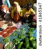 ORISSA,  INDIA - NOV 12: Indian villagers sell eggplant  and other vegetables on Nov 12, 2009 in Orissa, India - stock photo