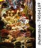 ORISSA, INDIA - NOV 10 -Tribal villagers bargain for vegetables on Nov 10, 2009, in Chatikona market, Orissa, India - stock photo