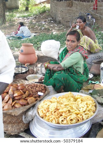ORISSA, INDIA - NOV 11  - Woman prepares fried food for snacks at a  weekly market on Nov 10, 2009 in Orissa, India - stock photo