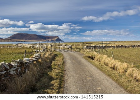 Orkney country lane - stock photo