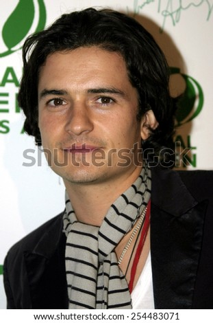 Orlando Bloom attends the Global Green Pre-Oscar Party held at the Day After Club in Hollywood, California on February 24, 2005.  - stock photo