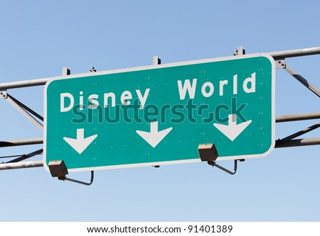 ORLANDO - DECEMBER 22: A sign in Orlando, FL points to the Walt Disney World Resort on December 22, 2011. With more than 47 million visitors in 2010, it is world's most visited entertainment resort. - stock photo