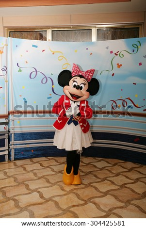 ORLANDO - FEB 3:  Minnie Mouse appears for the departing of the new Disney Dream Cruise in Port Canaveral on Feb 3, 2013 in Orlando, Florida. - stock photo