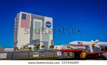 ORLANDO, FL - DEC 14, 2014: NASA Vehicle Assembly Building, Orlando, Florida on a sunny day. This building is used to assemble large American manned rockets and will be used to launch upcoming Space Launch System - stock photo
