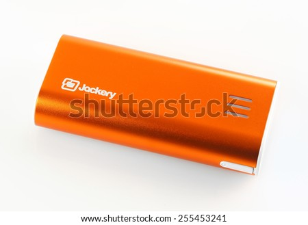 ORLANDO, FL - FEBRUARY 23, 2015: Jackery Bar is a high-capacity battery pack and portable phone charger with 6000mAh rechargeable external battery power capacity with 2.1A output. - stock photo