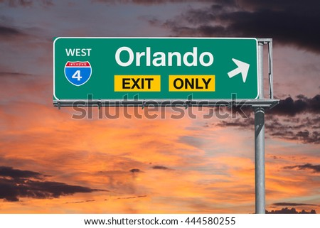Orlando Florida exit only freeway sign with sunrise sky. - stock photo