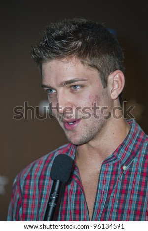 ORLANDO, FLORIDA - FEB. 24: Basketball star forward Chandler Parsons of the Houston Rockets attends the VIP All-Star party hosted by Dwight Howard and Adidas.  Feb. 24, 2012 in Orlando Florida. - stock photo