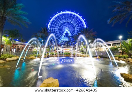 ORLANDO, FLORIDA, USA - APRIL 30, 2016: The Orlando Eye is a 400 feet tall ferris wheel in the heart of Orlando and the largest observation wheel on the east coast - stock photo