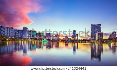 Orlando, Florida, USA downtown city skyline on Eola Lake. - stock photo