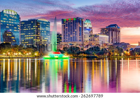 Orlando, Florida, USA skyline at dusk on Eola Lake. - stock photo