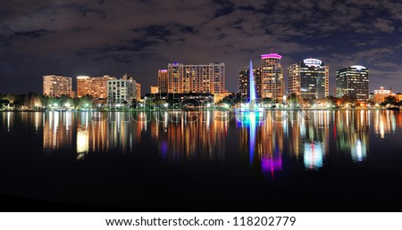Orlando Lake Eola panorama with office buildings at night - stock photo
