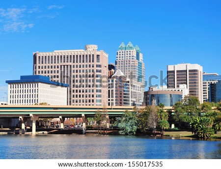 Orlando Lake Lucerne panorama in the morning with office buildings and bridge - stock photo