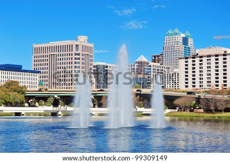 Orlando Lake Lucerne panorama in the morning with office buildings, bridge and fountain - stock photo
