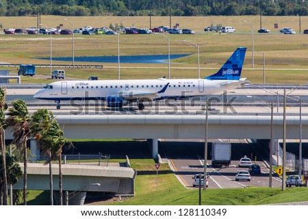 ORLANDO - SEPTEMBER 4: Embraer 145 JetBlue taxiing on Orlando Airport runway located in Orlando USA on September 4, 2012. JetBlue is the fastest growing airline in the world using Airbuse and Embraers - stock photo