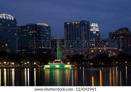Orlando skyline at twilight. Lake Eola in foreground.