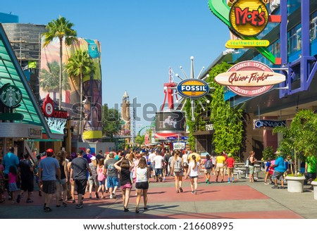 ORLANDO,USA - AUGUST 23, 2014 : A crowd of visitors walking towards the entrance of the Universal Orlando Resort theme parks - stock photo