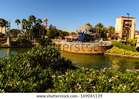 ORLANDO, USA - DECEMBER 19, 2013: Universal Logo in front of Universal Studios Orlando. Universal Studios Orlando is a theme park resort in Orlando, Florida. - stock photo