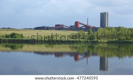 ORLOVA LAZY, CZECH REPUBLIC, AUGUST 12, 2015: Black coal mine, reclaimed surface coal mining with pond, Northern Moravia, Europe, EU