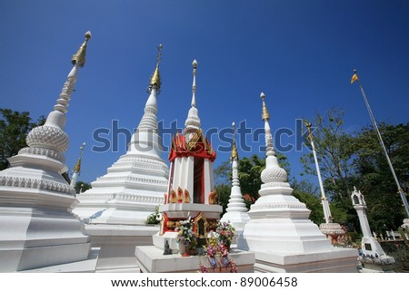 Ornament: Beautiful white pagodas of  traditional Mon architecture style at Chomphuwek wat in Nonthaburi province, Thailand