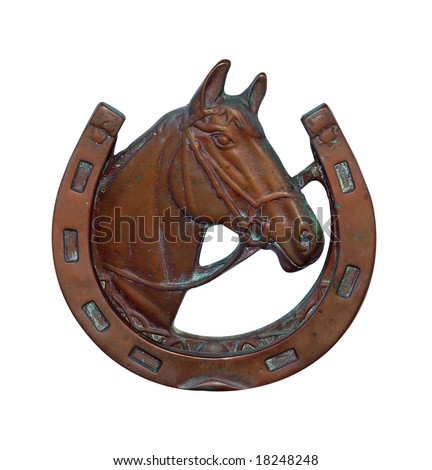 Ornamental Horse Shoe with Horse head isolated with clipping path - stock photo