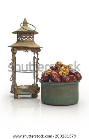 ornamental of ripped dates and a vintage Lantern / Ramadan Lamp  - stock photo