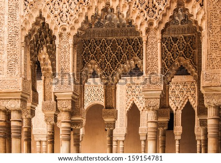 Ornamental plasterwork in an arcade in the Nasrid palaces, at the Alhambra, Granada, Spain. - stock photo