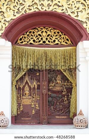 "ornamental relief on the window of  buddhist temple ""wat buparan"" Chiang mai province, Thailand"