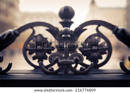 Ornamented iron fence  element vintage look - stock photo
