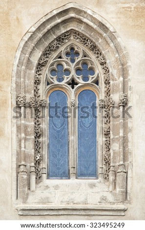 Ornamented window of a cathedral in gothic style - stock photo
