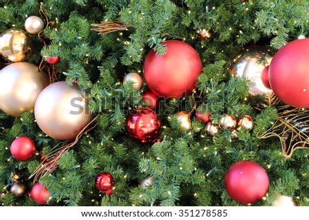Ornaments on the Christmas tree (Christmas background) - stock photo