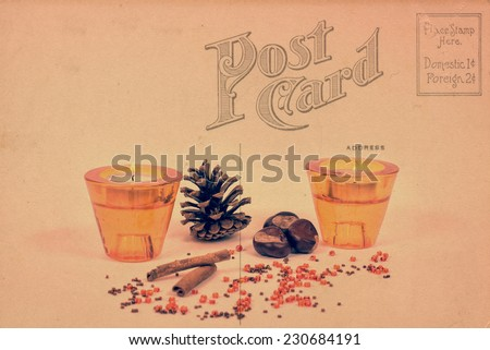 Ornaments with candles and pine cones on a postcard - stock photo