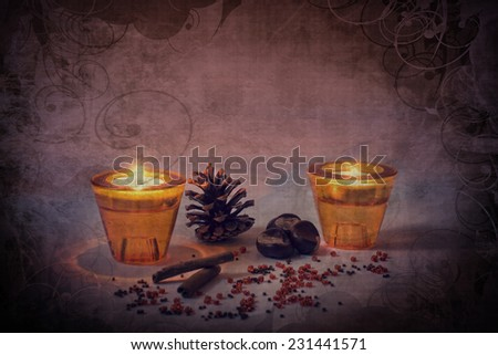 Ornaments with candles and pine cones on grungy background - stock photo