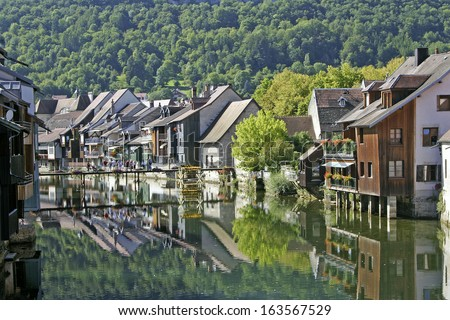 Ornans and the Loue river,  the Franche-Comte region of eastern France - stock photo
