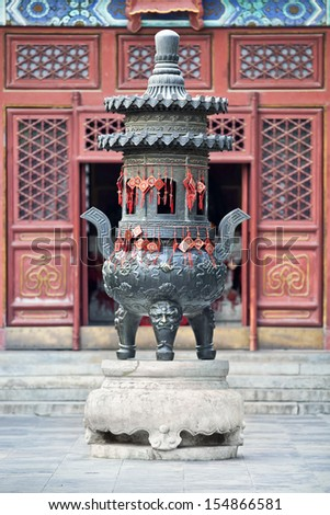 Ornate altar hanged with wish cards in a Buddhist temple, Beijing, China - stock photo