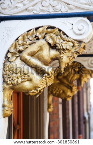 ornate atlas at a house in Oxford, England - stock photo