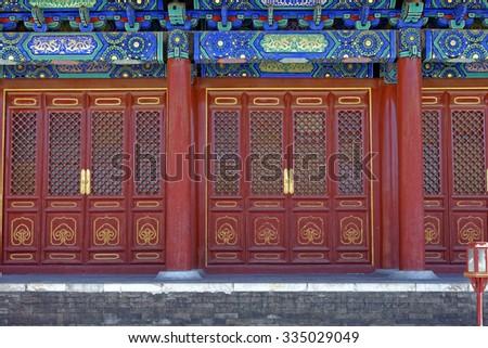 Ornate building door design in the Temple of Heaven complex in Beijing, China - stock photo