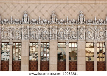Ornate building facade in Hollywood, California with carvings of historic and medieval figureheads. One resembles William Shakespeare. - stock photo