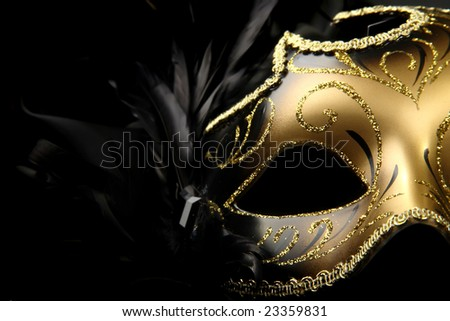 ornate carnival mask over black silk background - stock photo
