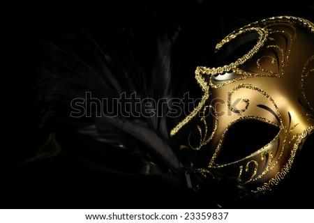 ornate carnival mask over black silk background - stock photo