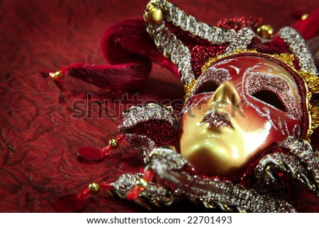 ornate carnival mask over red textured background - stock photo