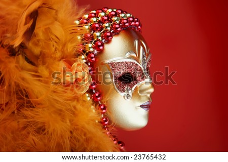 ornate carnival mask over textured metallic background - stock photo