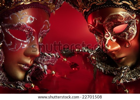 ornate carnival masks over textured metalic background