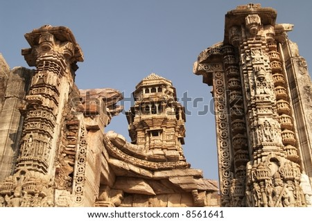 Ornate carved stone victory tower (Vijay Stambha) built to celebrate an ancient victory. Chittaugarh, Rajasthan, India. - stock photo