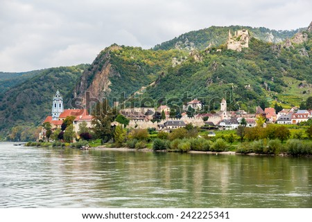 Ornate church and buildings on banks of River Danube in Durnstein, Austria - stock photo