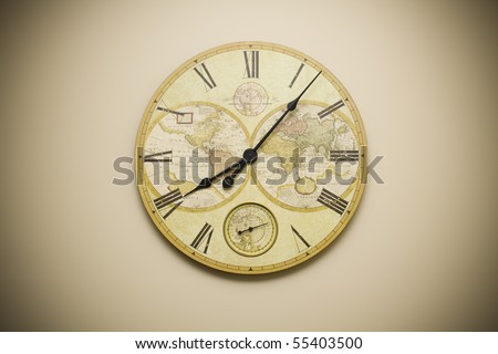 Ornate clock with map of world on it - stock photo